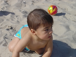 william's first crawl on the beach